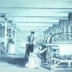 """Interior d'una fàbrica de teixits catalana durant el XIX amb treballadores""""."""
